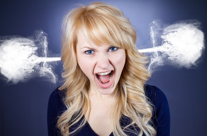 Angry woman with steam going out from ears